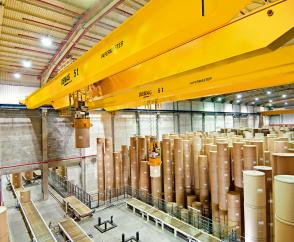 Seven fully automated crane installations in a shipping store for paper rolls